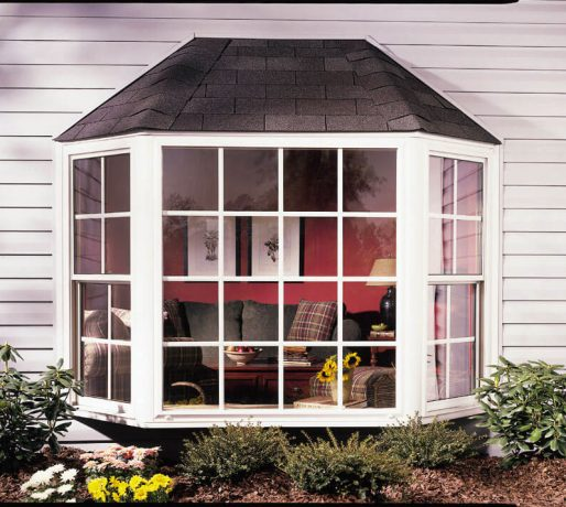 House with a window with colonial grids and siding installation in Schaumburg