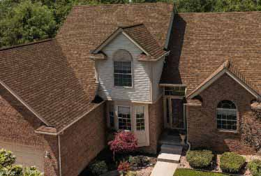 Big house with brick walls and siding installation in Schaumburg
