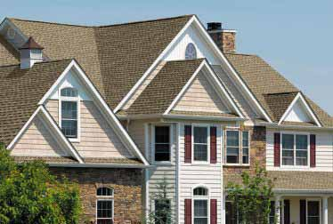 Big house with siding installation and brick walls