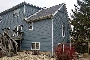 Big gray house with siding installed by siding contractor